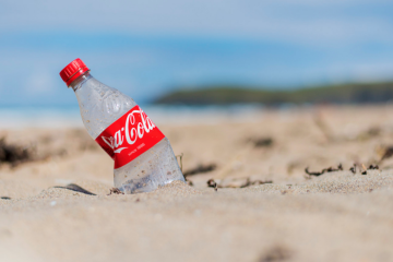 Coca-Cola bottle on beach