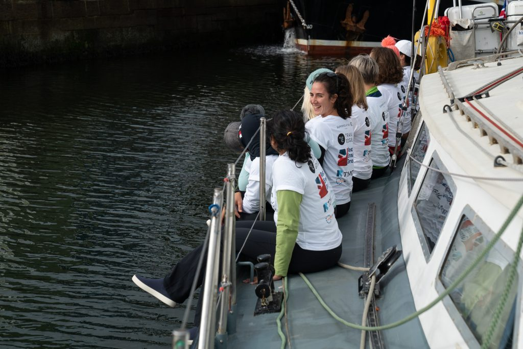 Some of the all-female team aboard the S.V TravelEdge before it's Plymouth launch for the eXXpedition.